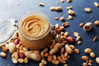 Peanut Butter Mason Jar with Peanuts Surrounding