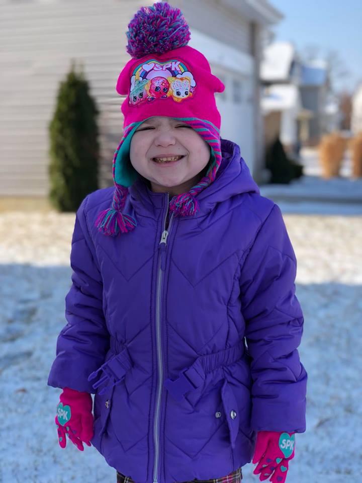 Vivian Lemire purple winter coat.jpg