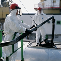 Oil Workers wearing Tyvek® coveralls