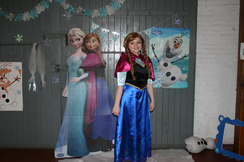 Girl in Frozen attire ready for the Frozen Ball